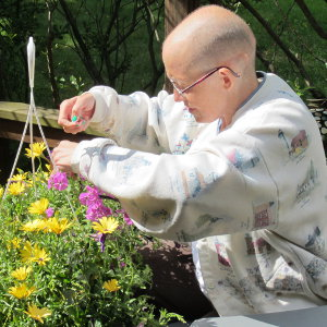 Image: Terri deadheading flowers in 2012.